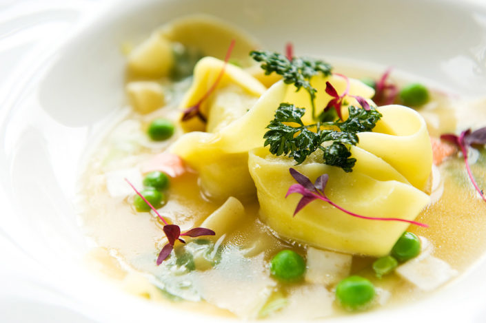 Ravioli in broth
